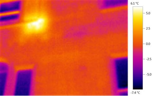 Thermal Imaging: Heat from Radiator seens from outside of Gerogian house