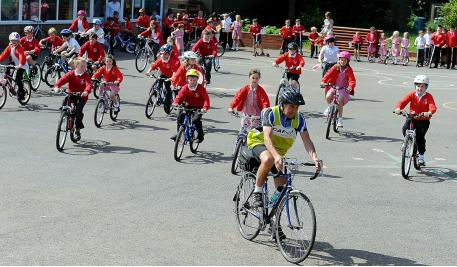 Pupils Riding Bicycles at School